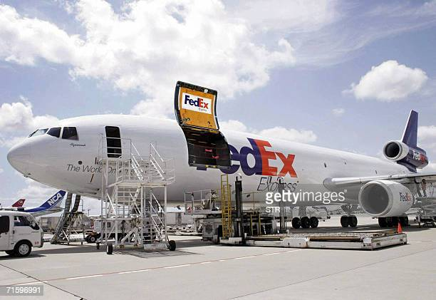Boxes of beef meat imported from the United States are unloaded from a cargo plane at the Narita International Airport suburban Tokyo 07 August 2006...