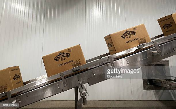 Boxes of beverages move along a conveyor belt at Turkey Hill LP's production facility in Contestoga Pennsylvania US on Monday Nov 21 2011 Turkey Hill...