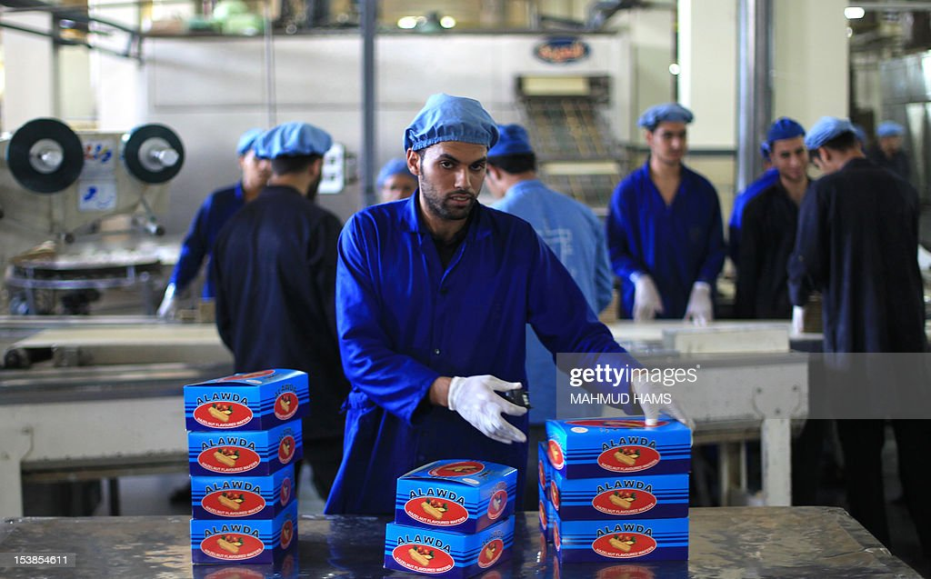 Boxes of biscuits are made ready by Palestinian workers at the al-Awda factory in Deir al-Balah, in the central Gaza strip, on October 10, 2012. The World Food Program (WFP) will export the biscuits to United Nation run schools in the Israeli occupied Palestinian West Bank, the first time since 2006 when the Gaza Strip was put under an Israeli blockade.