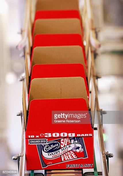 Boxes of Cadbury's chocolate on the production line in the factory February 25 2005 in Birmingham England The company is celebrating 100 years of...