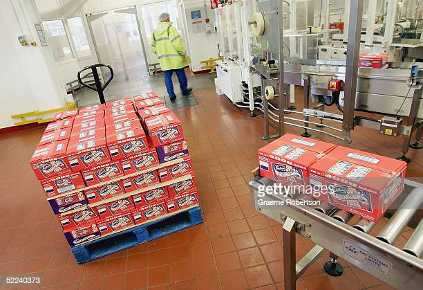 Boxes of Cadbury's chocolate sit ready to go to the warehouse on February 25 2005 in Birmingham England The company is celebrating 100 years of...