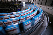 Boxes of cake mix on packing line in factory (blurred motion)
