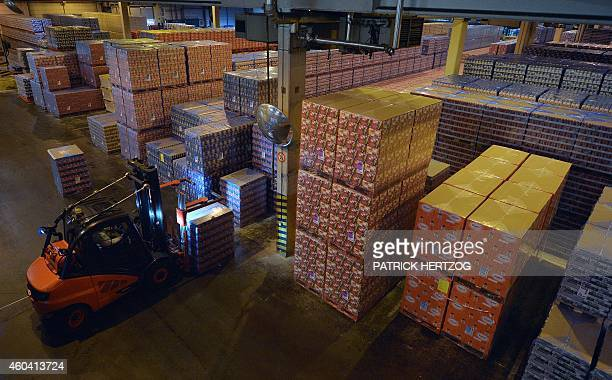 Boxes of cans of beer are seen stacked at the Kronenbourg brewery on December 12 2014 at the main factory in the eastern French city of Obernai AFP...