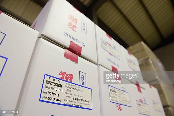 Boxes of Dassaibranded sake bound for Melbourne Australia sit at the Asahishuzo Co brewery manufacturing Dassaibranded sake in Iwakuni Yamaguchi...
