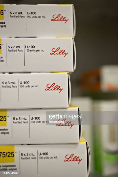 Boxes of Eli Lilly Co Humalog brand kwikpen insulin delivery devices are arranged for a photograph at a pharmacy in Princeton Illinois US on Monday...