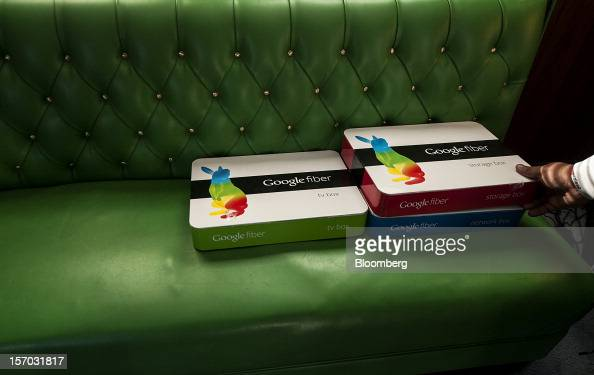 Boxes of equipment needed to install Google Fiber broadband network sit on a couch at the home of customer Becki Sherwood in Kansas City Kansas US on...