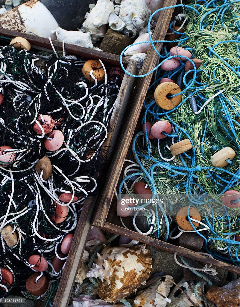 Boxes of fishing nets on Britannia beach. : Stock Photo