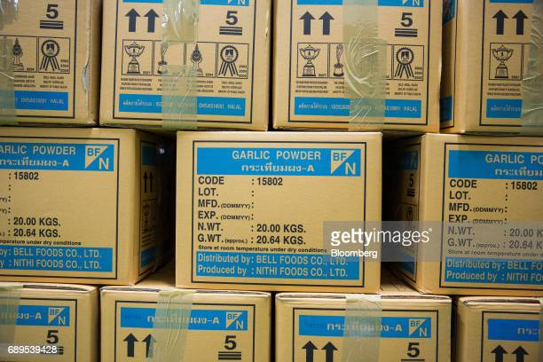 Boxes of garlic powder sit stacked inside a warehouse at a Nithi Foods Co factory in the San Pa Tong district of Chiang Mai Thailand on Tuesday May...