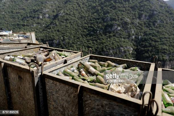 Boxes of glass bottles are seen at a waste treatment plant in the area of Monteverde east of Beirut on October 27 2017 The Lebanese divers plunge...