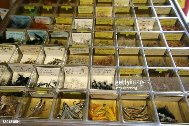 Boxes of hand tied flies at Charles Bright Fishing Supplies