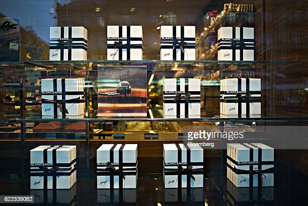 Boxes of handmade truffles sit on display in the window of Confiserie Sprungli AG chocolatier in Zurich Switzerland on Wednesday Nov 9 2016 Donald...