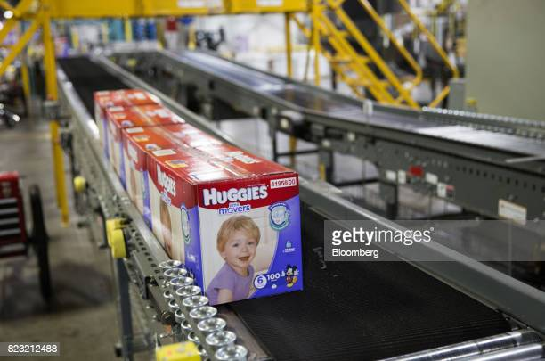 Boxes of Huggies brand diapers move along a conveyor belt at the KimberlyClark Corp manufacturing facility in Paris Texas US on Tuesday Oct 27 2015...