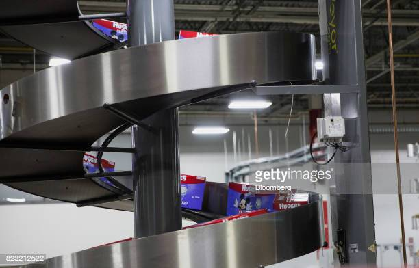 Boxes of Huggies brand diapers move down a spiral conveyor belt at the KimberlyClark Corp manufacturing facility in Paris Texas US on Tuesday Oct 27...