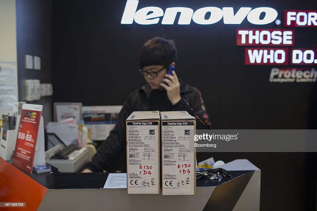 Boxes of Lenovo Group Ltd. ThinkPad Edge E130's sit on a counter at a Lenovo store in the Sha Tin district of Hong Kong, China, on Friday, Feb. 7, 2014. Lenovo, which has headquarters in Beijing and Morrisville, North Carolina, agreed to pay $2.3 billion for IBMs low-end server unit on Jan. 23, adding a business with wider profit margins than PCs and giving it about 14 percent of the market. Photographer: Brent Lewin/Bloomberg via Getty Images
