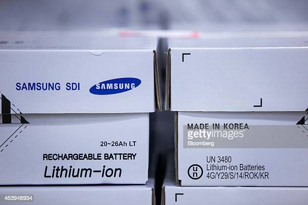 Boxes of lithiumion rechargable battery cells manufactured by Samsung SDI Co are seen at the Bayerische Motoren Werke AG automobile manufacturing...