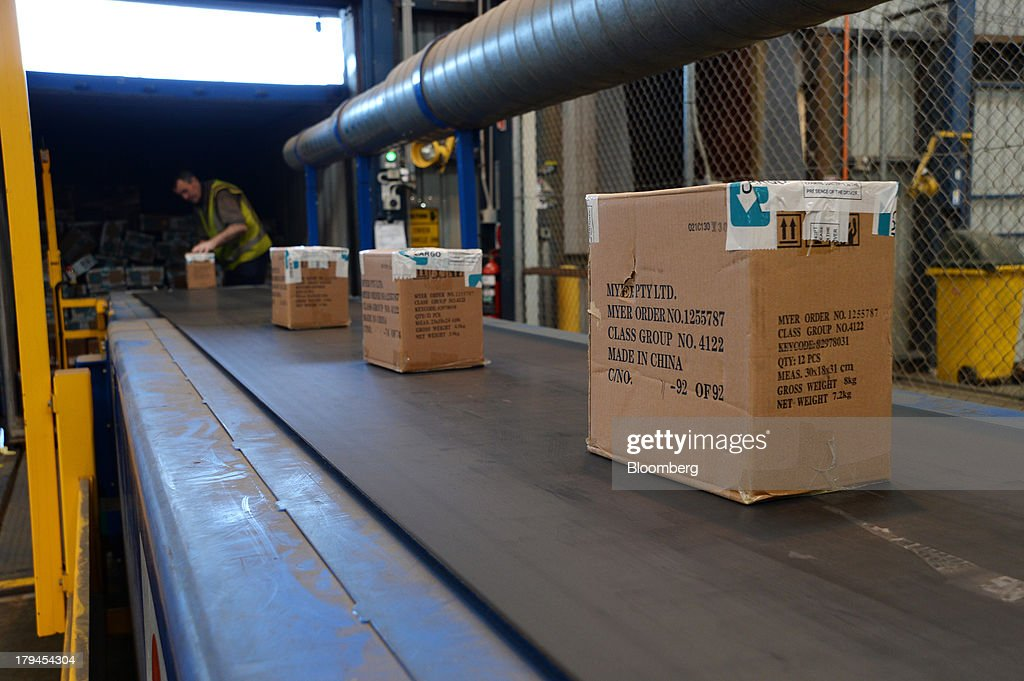Boxes of merchandise are unloaded from a truck onto a conveyor belt at the Myer Holdings Ltd. distribution center in Melbourne, Australia, on Tuesday, Sept. 3, 2013. A Bureau of Statistics report released in Sydney on Sept. 4 showed household spending climbed 0.4 percent in the second quarter, adding 0.2 percentage point to gross domestic product growth. Photographer: Carla Gottgens/Bloomberg via Getty Images