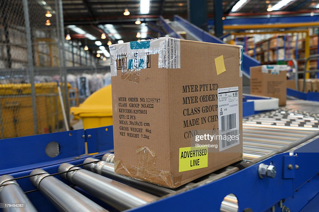 Boxes of merchandise travel along a conveyor to be sorted and distributed at the Myer Holdings Ltd. distribution center in Melbourne, Australia, on Tuesday, Sept. 3, 2013. A Bureau of Statistics report released in Sydney on Sept. 4 showed household spending climbed 0.4 percent in the second quarter, adding 0.2 percentage point to gross domestic product growth. Photographer: Carla Gottgens/Bloomberg via Getty Images