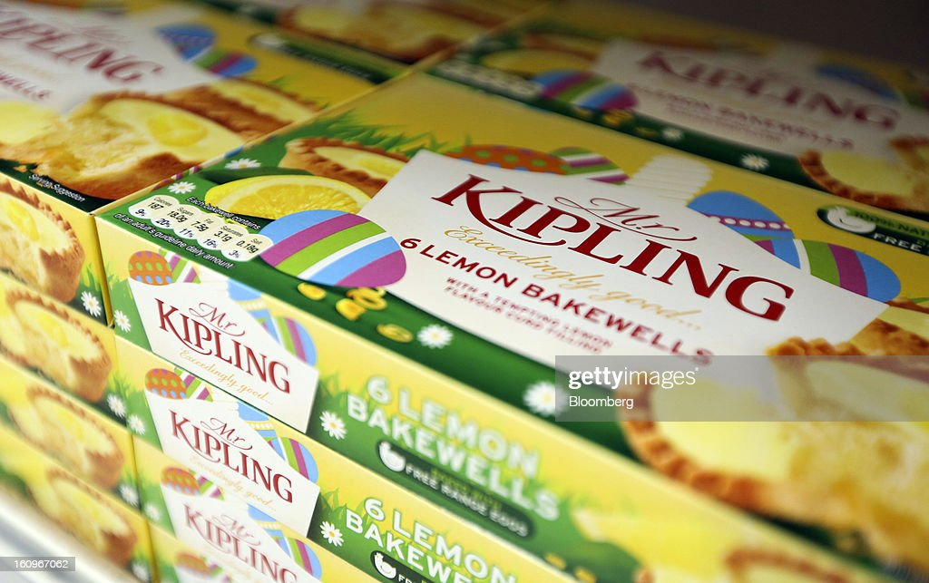 Boxes of Mr. Kipling brand lemon bakewell tarts, produced by Premier Foods Plc, sit on a shelf inside a supermarket in London, U.K., on Friday, Feb. 8, 2013. Britain's economy will grow more slowly this year than previously forecast and stagnation may persist, according to the National Institute of Economic and Social Research. Photographer: Chris Ratcliffe/Bloomberg via Getty Images