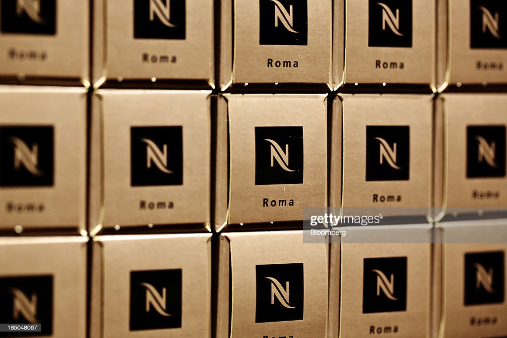 Boxes of Nespresso single-serve coffee capsules sit displayed for sale inside the Nestle SA store next to the company's headquarters in Vevey, Switzerland, on Thursday, Oct. 17, 2013. Nestle SA, the world's biggest food company, reported nine-month sales that were below its full-year target rate, highlighting the difficult environment faced by the makers of consumer products. Photographer: Gianluca Colla/Bloomberg via Getty Images