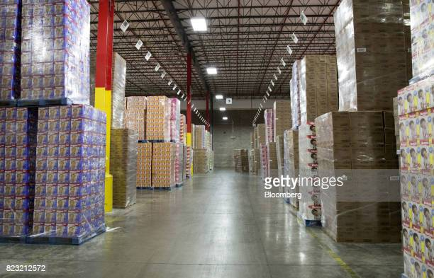 Boxes of packaged products sit stacked in the warehouse of the KimberlyClark Corp manufacturing facility in Paris Texas US on Tuesday Oct 27 2015...
