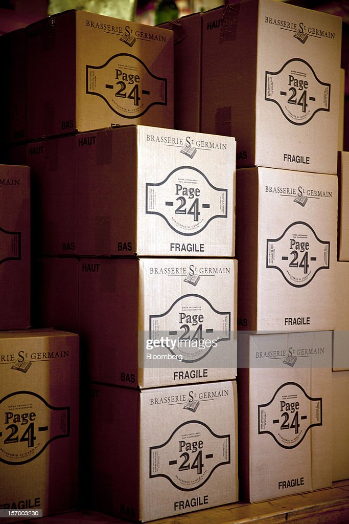 Boxes of Page 24 beer, produced by the brewer Brasserie Saint Germain, sit waiting for dispatch from the brewery in Aix-Noulette, in France, on Monday, Nov. 26, 2012. Producers of beer in France, for instance, say any development plans they had have been 'nipped in the bud' by Hollande's plan to boost the tax on the drink next year. Photographer: Balint Porneczi/Bloomberg via Getty Images