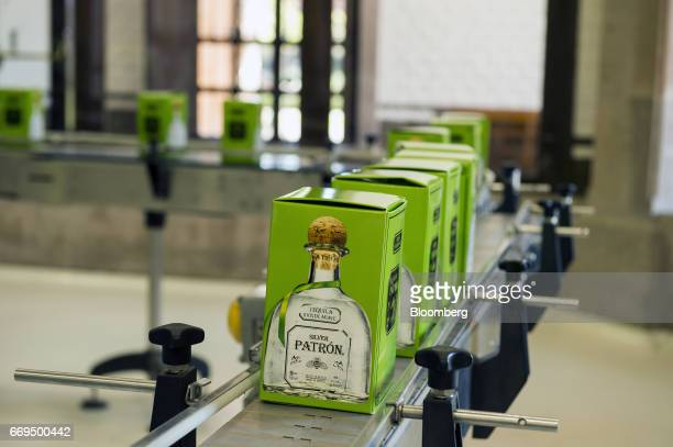Boxes of Patron Spirits Co brand Silver Tequila move down a conveyor belt at the company's distillery in Atotonilco El Alto Jalisco Mexico on Tuesday...