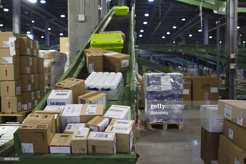 Boxes of pharmaceutical products sit on a conveyor belt before distribution to customers at the Cofares SA logistical plant in Guadalajara, Spain, on Wednesday, Jan. 30, 2013. Madrid, the second-biggest contributor to Spain's economy after Catalonia, has sliced 1 billion euros from its budget in 2012, increasing public-transportation costs and university fees, cutting jobs, delaying investments and reducing health-care and social benefits. Photographer: Angel Navarrete/Bloomberg via Getty Images