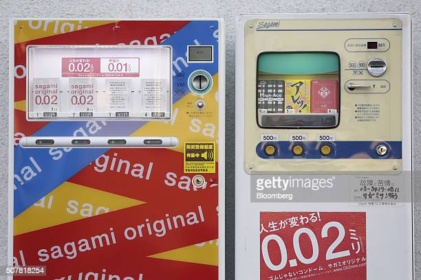 Boxes of Sagami Rubber Industries Co condoms including the Sagami Original 002 left sit on display inside vending machines outside the company's head...