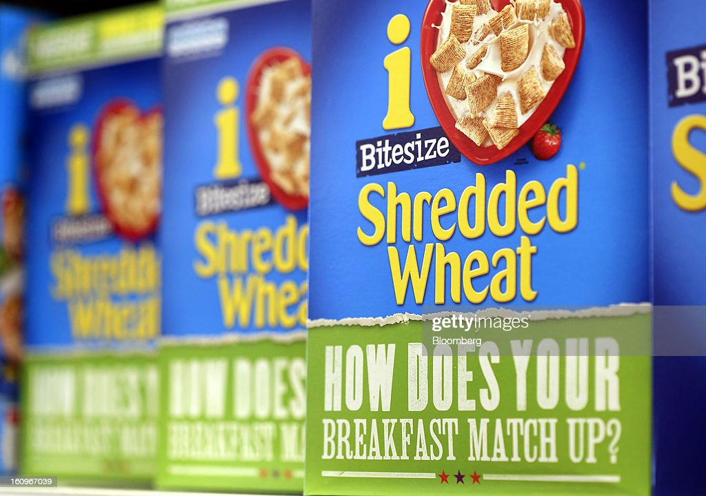 Boxes of Shredded Wheat 'Bitesize' breakfast cereal, produced by Nestle SA, sit on a shelf inside a supermarket in London, U.K., on Friday, Feb. 8, 2013. Britain's economy will grow more slowly this year than previously forecast and stagnation may persist, according to the National Institute of Economic and Social Research. Photographer: Chris Ratcliffe/Bloomberg via Getty Images