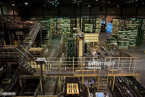 Boxes of Staropramen beer move along the mechanised production line into the storeroom at the Pivovary Staropramen AS brewing company operated by...