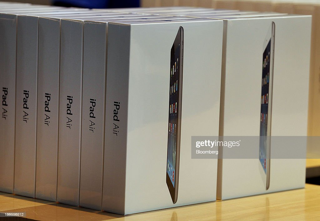 Boxes of the new Apple Inc. iPad Air are displayed on the first day of sales at a store in Palo Alto, California, U.S., on Friday, Nov. 1, 2013. Apple Inc.'s forecast for the slowest holiday sales growth in a half decade reflects how iPhones and iPads aren't providing the growth surges they once did as competition accelerates in the saturated mobile market. Photographer: Tony Avelar/Bloomberg via Getty Images