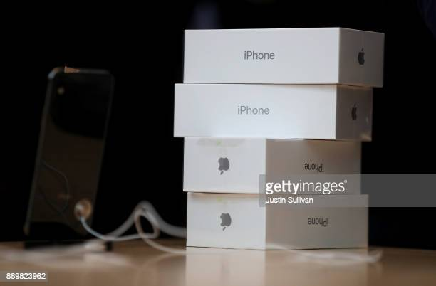 Boxes of the new iPhone X sit on a table at an Apple Store on November 3 2017 in Palo Alto California The highly anticipated iPhone X went on sale...