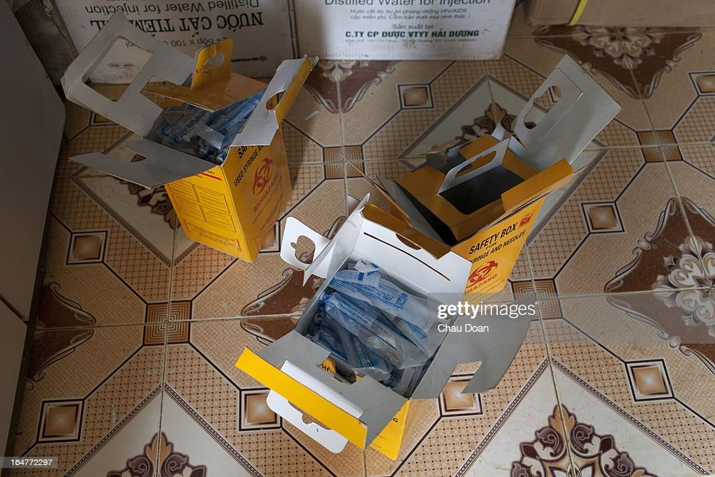 Boxes of used syringes and needles, returned by drug addicts, are prepared for safe destruction at the center for health counseling and voluntary HIV testing, at the Muong Ang Health Center. Drug addicts can pick up clean, new syringes and needles from the center..