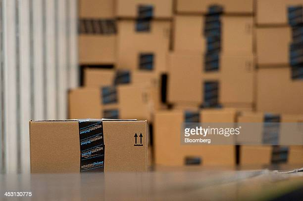 Boxes sit stacked before being loaded on a truck at the Amazoncom Inc fulfillment center in Phoenix Arizona US on Monday Dec 2 2013 More than 131...