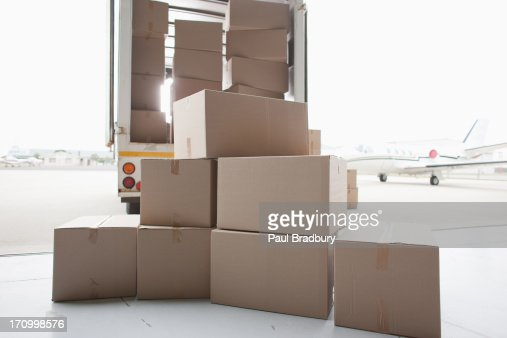 Boxes waiting to be loaded onto truck : Stock Photo