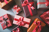 Stylishly packaged boxes with gifts closeup.