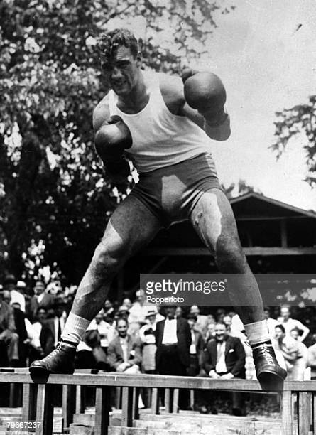 Boxing 13th June World Heavyweight boxing champion Primo Carnera in fighting pose at his Pompton Lakes training camp New Jersey before his upcoming...