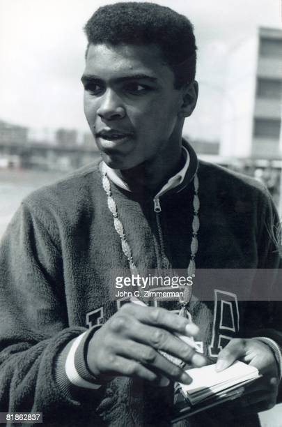 Boxing 1960 Summer Olympics Closeup of USA Cassius Clay victorious with medal after winning light heavyweight fight Rome ITA 8/25/19609/11/1960