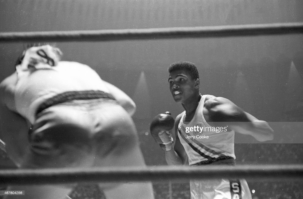 USA Cassius Clay in action during Men's Light-Heavyweight Gold Medal bout vs Poland Zbigniew Pietrzykowski at Palazzo dello Sport. Jerry Cooke X6933 TK11 R5 F29 )