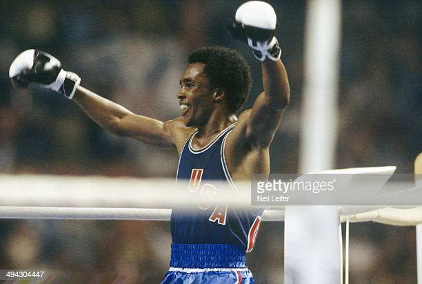 1976 Summer Olympics Closeup of USA Sugar Ray Leonard victorious after winning Light Welterweight Final gold vs Cuba Andres Aldama at Montreal Forum...