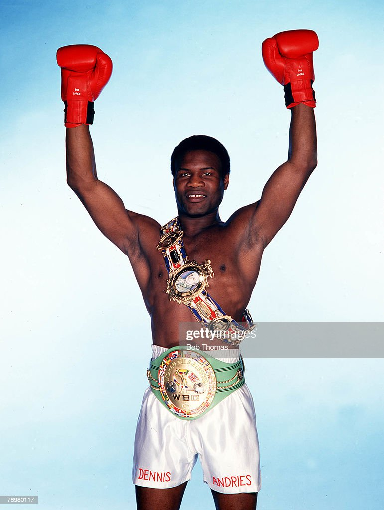Boxing, 1980s, British Light-Heavyweight Champion Boxer Dennis Andries wearing two championship belts in a victorious pose