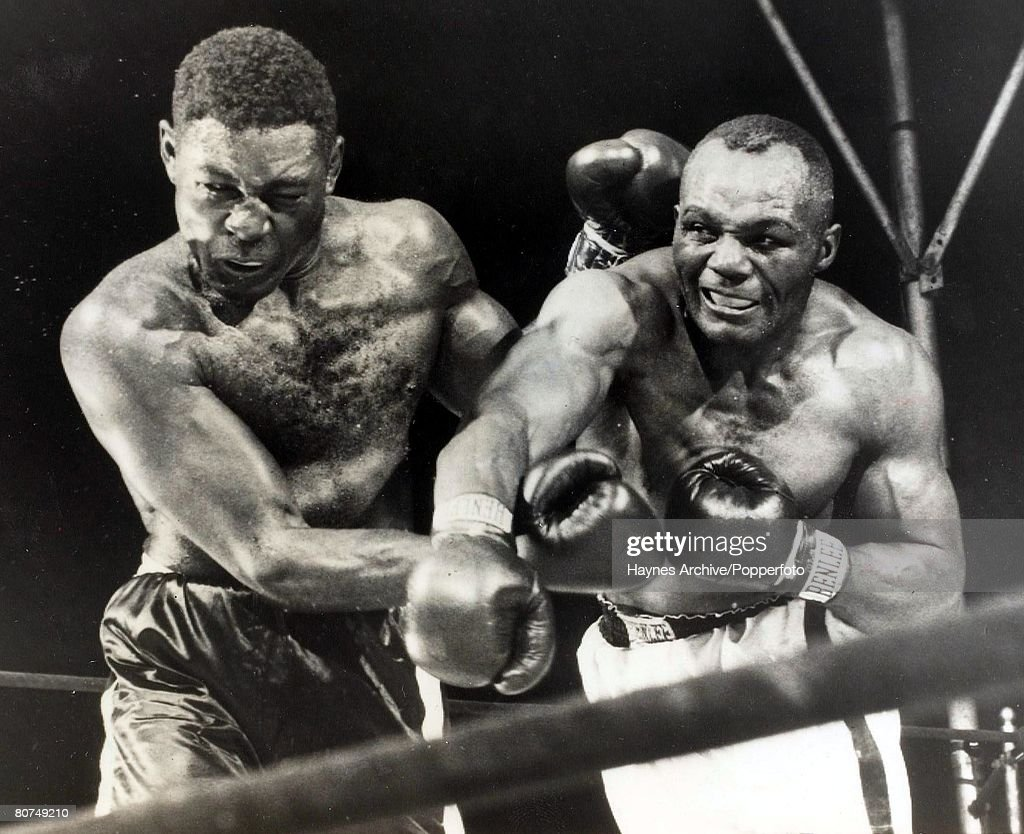 Boxing, 5th June 1952, Philadelphia, USA, A picture of Jersey Joe Walcott (right) landing a right cross on <a gi-track='captionPersonalityLinkClicked' href=/galleries/search?phrase=Ezzard+Charles&family=editorial&specificpeople=215068 ng-click='$event.stopPropagation()'>Ezzard Charles</a> on his way to defending his World heavyweight title with a points victory over 15 rounds