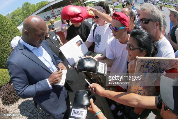 Boxing champion and 2017 inductee Evander Holyfield signs autographs during the International Boxing Hall of Fame induction Weekend of Champions...