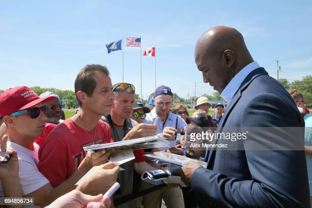 Boxing champion Evander Holyfield signs autographs during the International Boxing Hall of Fame induction Weekend of Champions event on June 11 2017...