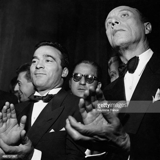 Boxing champion Marcel Cerdan and actor Louis Jouvet attend the Bal des Petits Lits Blancs party at Paris Opera on October 15 1948 in Paris France