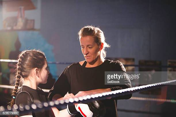 Boxing coach and student