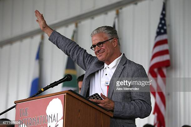 Boxing commentator Jim Lampley salutes as he speaks during the induction ceremony at the International Boxing Hall of Fame induction Weekend of...
