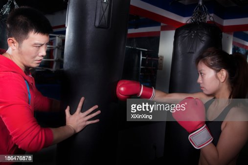 Boxing Couch Holding The Punching Bag And Training A