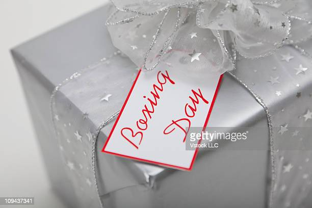 Boxing Day tag on wrapped silver gift