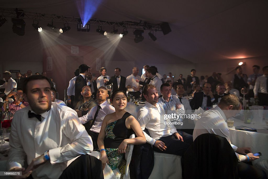 Boxing fans attend the Hedge Fund Fight Nite 2013 charity fighting event in Hong Kong, China, on Thursday, May 30, 2013. The event raises money for Operation Breakthrough and Operation Smile charities. Photographer: Jerome Favre/Bloomberg via Getty Images